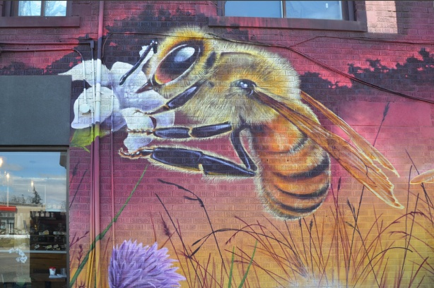 part of a nick sweetman pollinators mural, a bee
