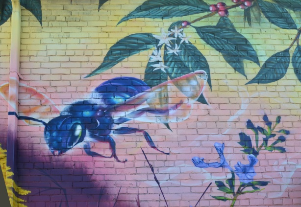 part of a nick sweetman pollinators mural, a blue bee