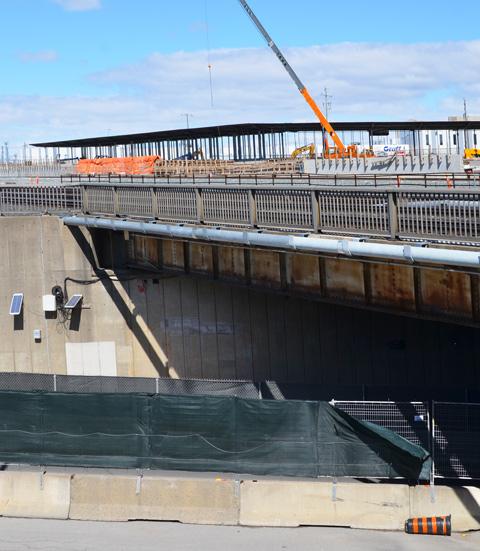 construction beside a bridge, underpass is a street