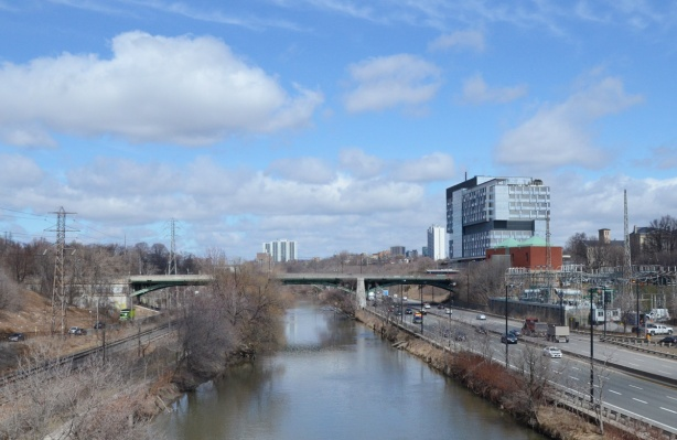 brige over the Don River, earl spring, no snow or ice but no leaves yet on the trees, Don Valley Parkway, road, to the right of the river, looking north towards Gerrard street