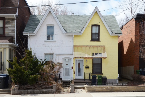 a semi-divided house, one side white and the other side yellow