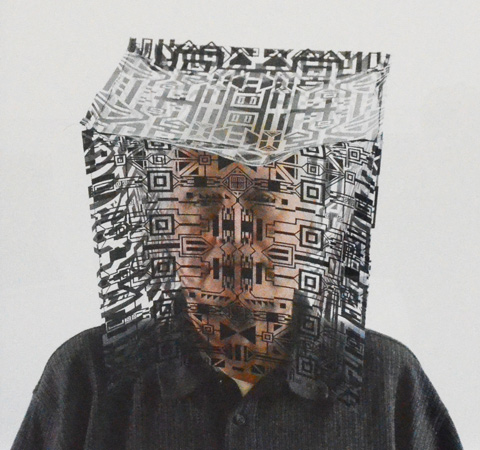 portrait of a man wearing a clear cube over his face. cube has black geometric drawings all over it so part of man's face is obscured