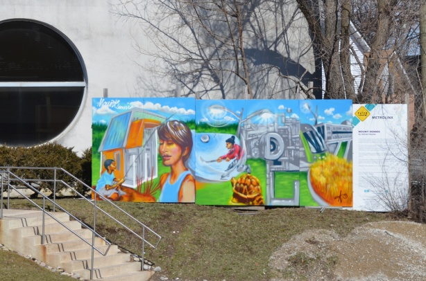 Mount Dennis Metrolinx mural by Adrian Hayles, people, a boy fishing, a person playing hockey, machinery, a turtle,
