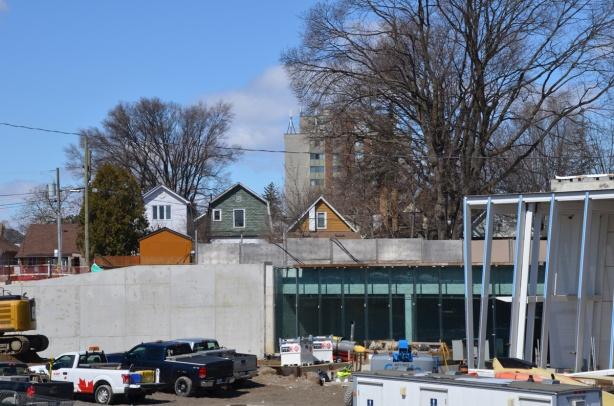back of houses behind construction of mount dennis LRT station