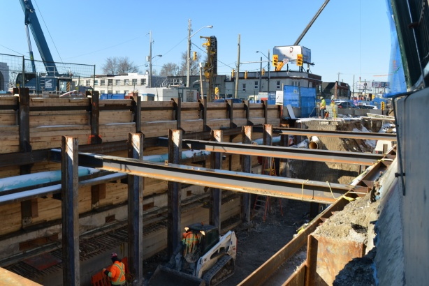 open pit excavation of underground LRT, steel cross beams and wood supports,