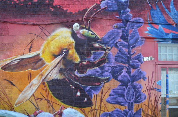 part of a nick sweetman pollinators mural, a bee on a purple flower