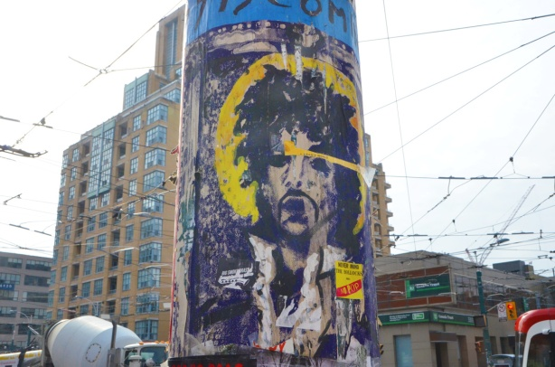 graffiti featuring face of Prince, on a utility pole