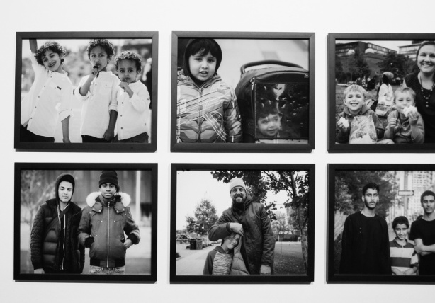 6 black and white photos of people on a wall in a gallery, photos of Regent Park residents, by Yasim Osman