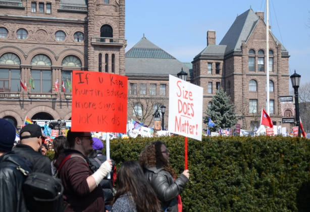 Crowds at a protest at Queens Park,