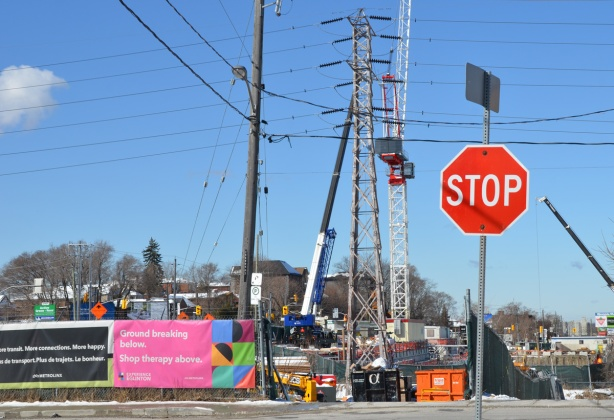 stop sign in front of a construction site on Eglinton Ave
