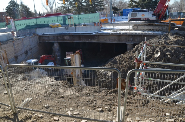 construction site, excavation and building under a road