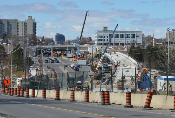 work on the west end of the corsstown lrt, after the tracks emerge from underground, raised track for a section before final station