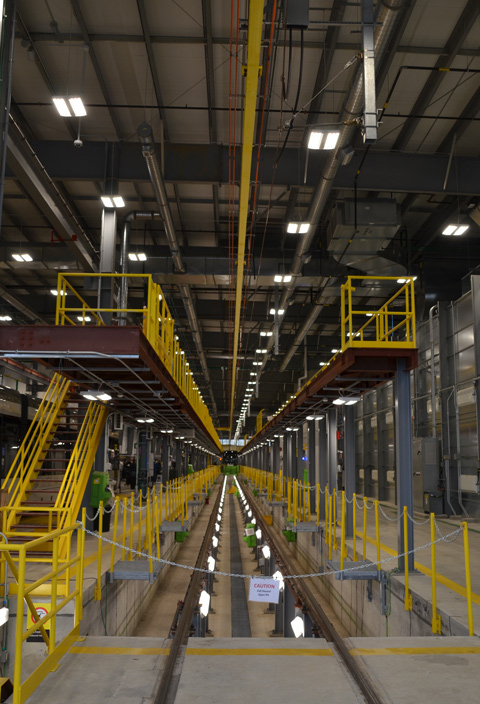 inside the new train maintenance building with three levels of access to the trains,