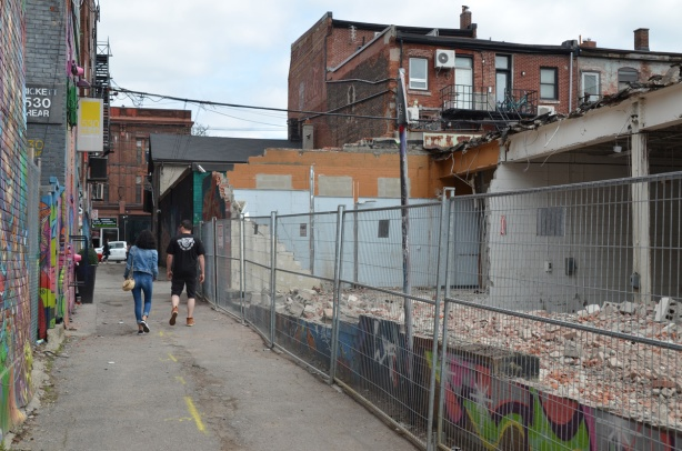demolition of building in graffiti alley