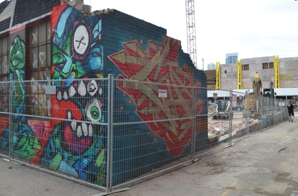 only one corner remaining, demolition of building in graffiti alley, covered with street art
