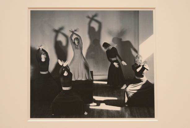 photograph from 1938 by Lotte Jacobi, of women dancing, light and shadows on the back wall