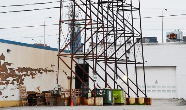 metal framework that is holding up a large billboard