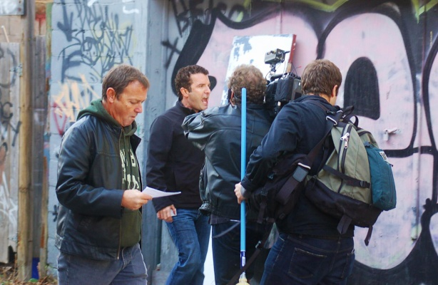 photo from 2011, Rick Mercer and film crew walking down Graffiti Alley as he filmed a rant for his TV program.