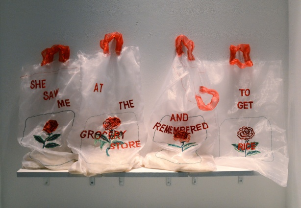 4 rice clear rice bags with red handles, with embroidery on them, red words that say, she saw me at the grocery store and remembered to get rice