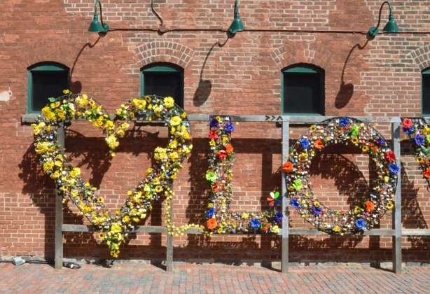 distillery district, love sign for locks, the heart has been decorated with a lot of yellow flowers