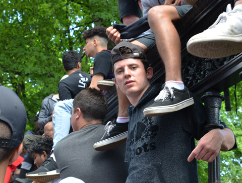 Raptors championship parade day, , young men sitting on the fence in front of Osgoode Hall