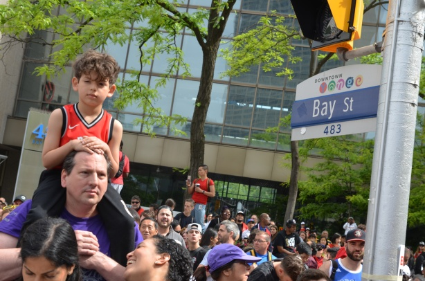 Raptors championship parade day, , boy on father's shoulders, Bay street, crowds