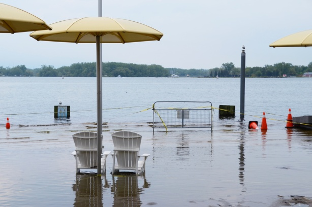 Toronto waterfront showing flooding at H 2 O park with its Muskoka chairs and yellow umbrellas