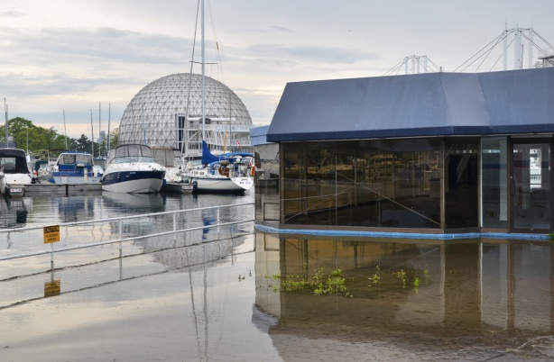 flooding at Ontario Place, empty building surrounded by water, boats, cinesphere dome