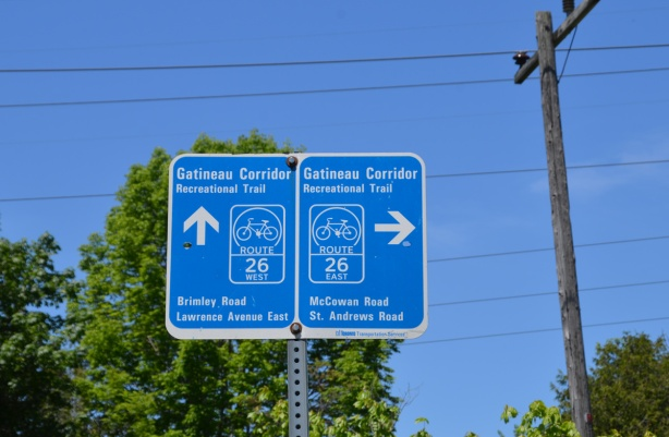 bike trail direction signs, Gatineau Corridor, right turn to McCowan Ave and left turn to Brimley Rd