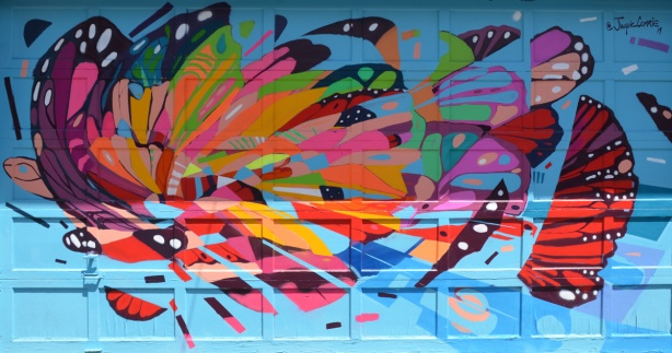 painted mural in a lane, butterfly, very abstract, by Jacquie Comrie