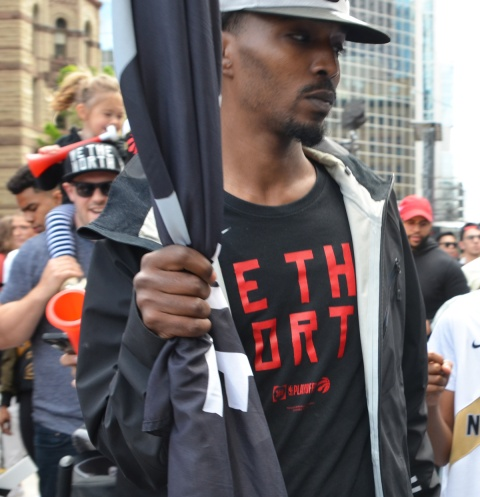 a man in a we the north t shirt carries a we the north flag
