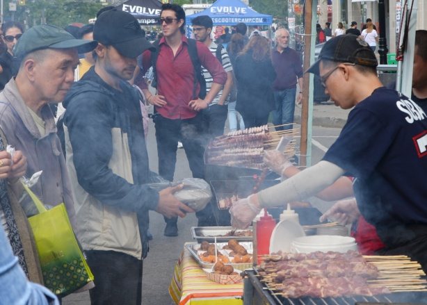grilling food at an outdoor street festival, taste of little italy