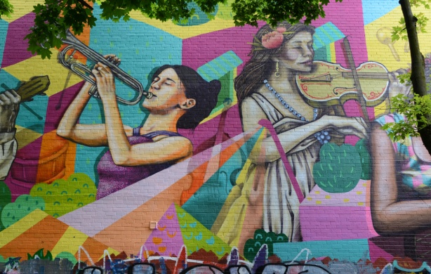 part of a mural, two women musicians, a trumpet player and a violin player