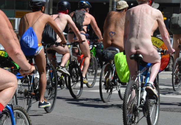 world naked bike ride - the behinds and backsides of a group of nude cyclists