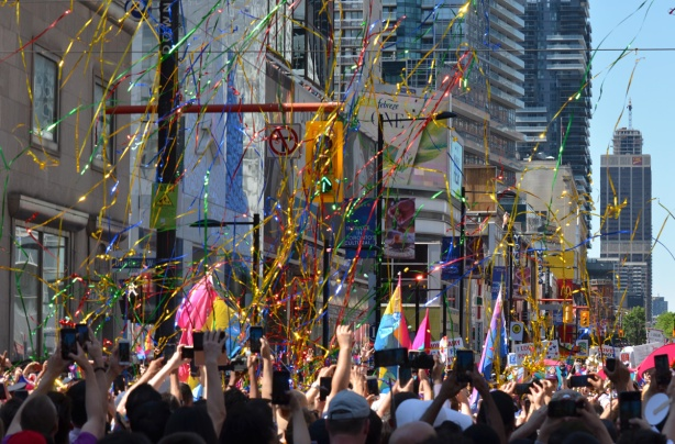 thousands of pieces of mylar in the air, just released over the heads of people watching the pride parade