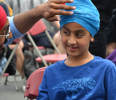 young person in blue turban