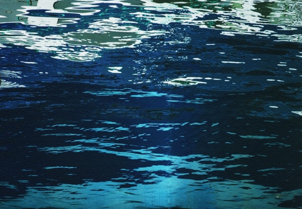 abstract in blues, made by close up of reflections and ripples in the water