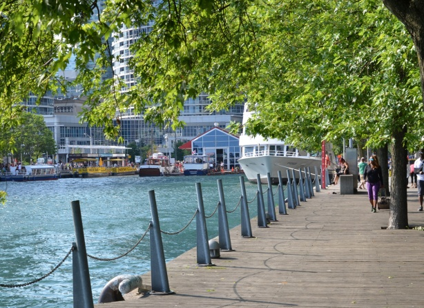 waterfront beside Harbour Square Park, walkway, trees, and boats