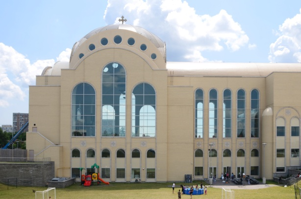 side view of very large pale brown cathedral church, St. Marks Coptic Church, new building,