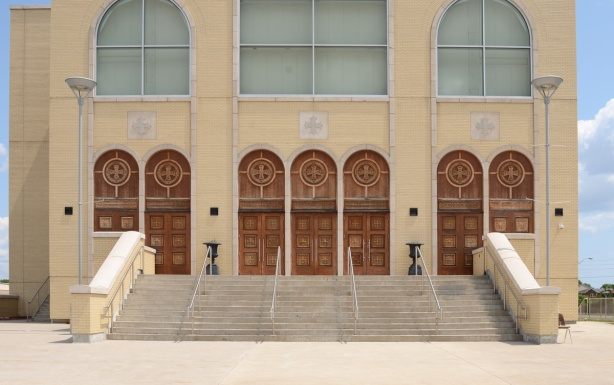 large front doors of very large pale brown cathedral church, St. Marks Coptic Church, new building,