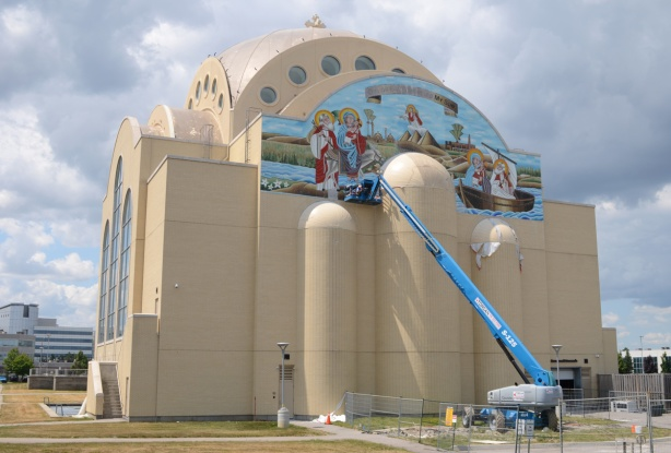 working on mosaic mural, very large pale brown cathedral church, St. Marks Coptic Church, new building,
