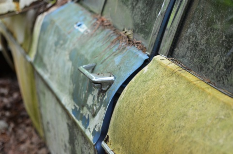 blue drivers door on yellow car, junked, car graveyard in Kendal
