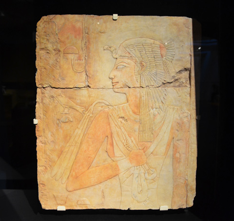 an old stone tablet from Ancient Egypt with picture of woman's profile