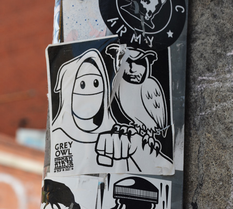 urban ninja squadron sticker with hooded ninja character with arm up, and owl on forearm, owl has face of Donald Trump