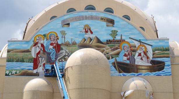 mosaic mural across the top end of very large pale brown cathedral church, St. Marks Coptic Church, new building,