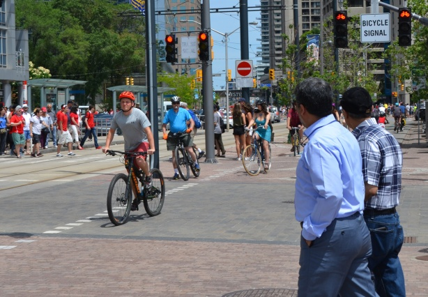 cyclists and pedestrians on Queens Quay
