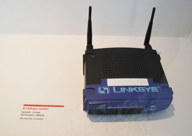 an old Linksys router on display in a museum show