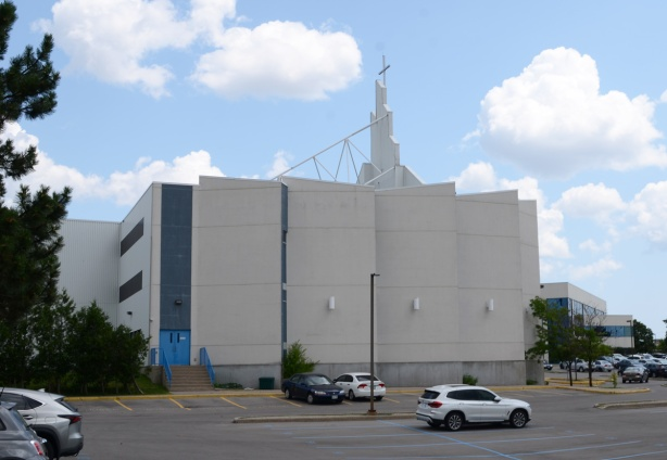 side view of part of front of modern white church, looks like an office building fro the side