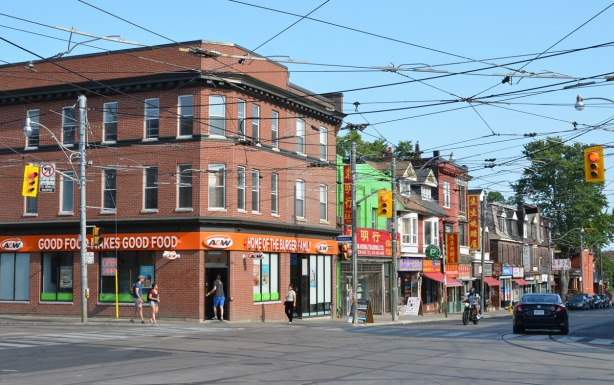 looking at the southeast corner of Broadview and Gerrard with a large A and W restaurant on the corner. Beyond that, the other stores and restaurants are Chinese