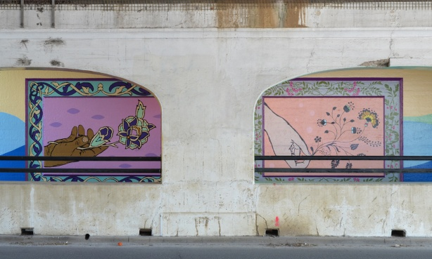 railway underpass street art, seen throughthe supporting concrete arches, paintings of hands holding flowers, framed